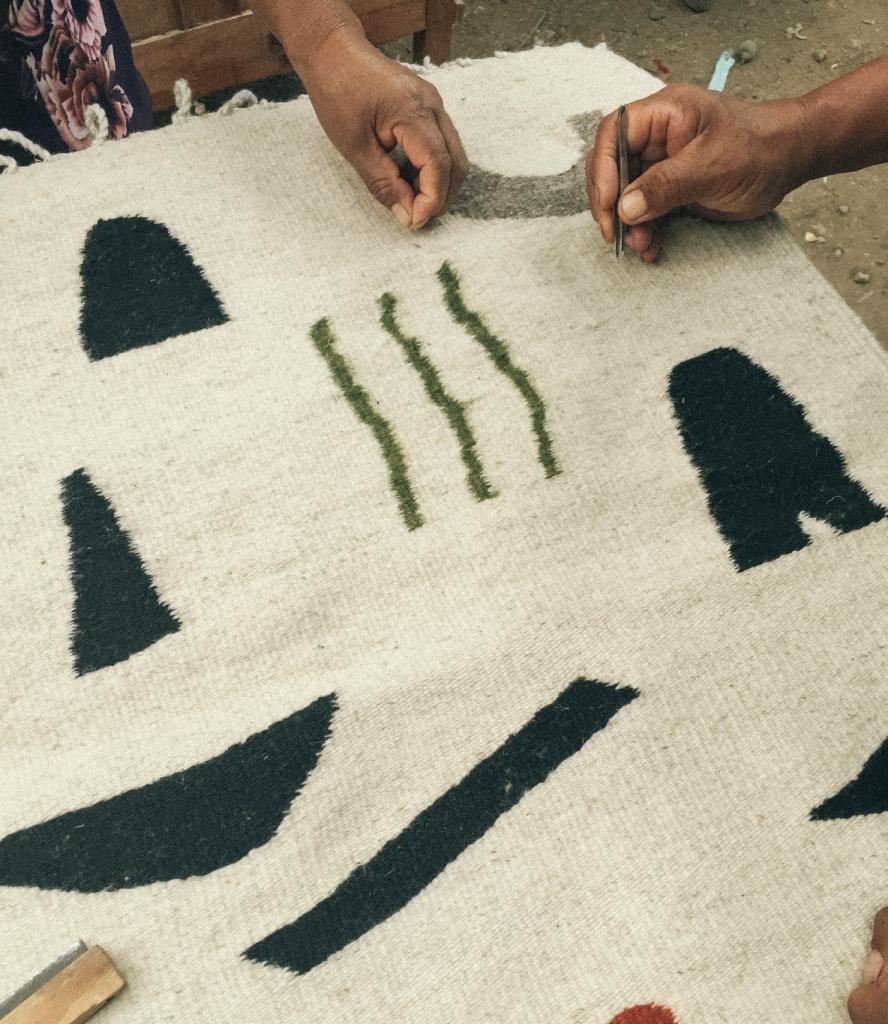 Artisans in Oaxaca, MX weaving tapestry designed by Mexican artist, M.A.