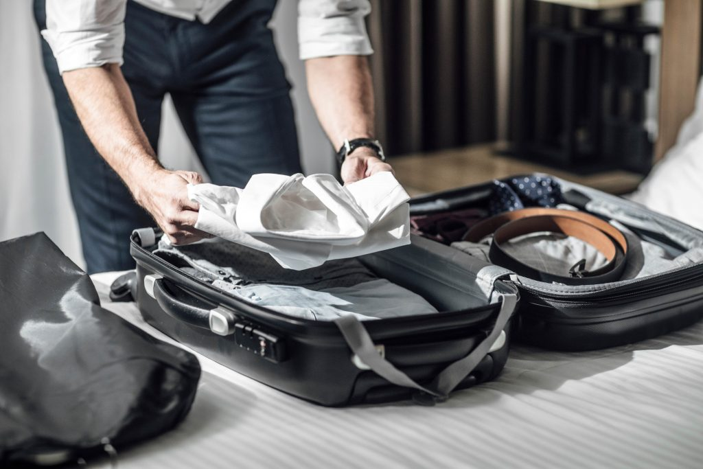 Business traveler packing his suitcase